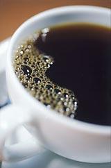 Šálek kávy s pěnou